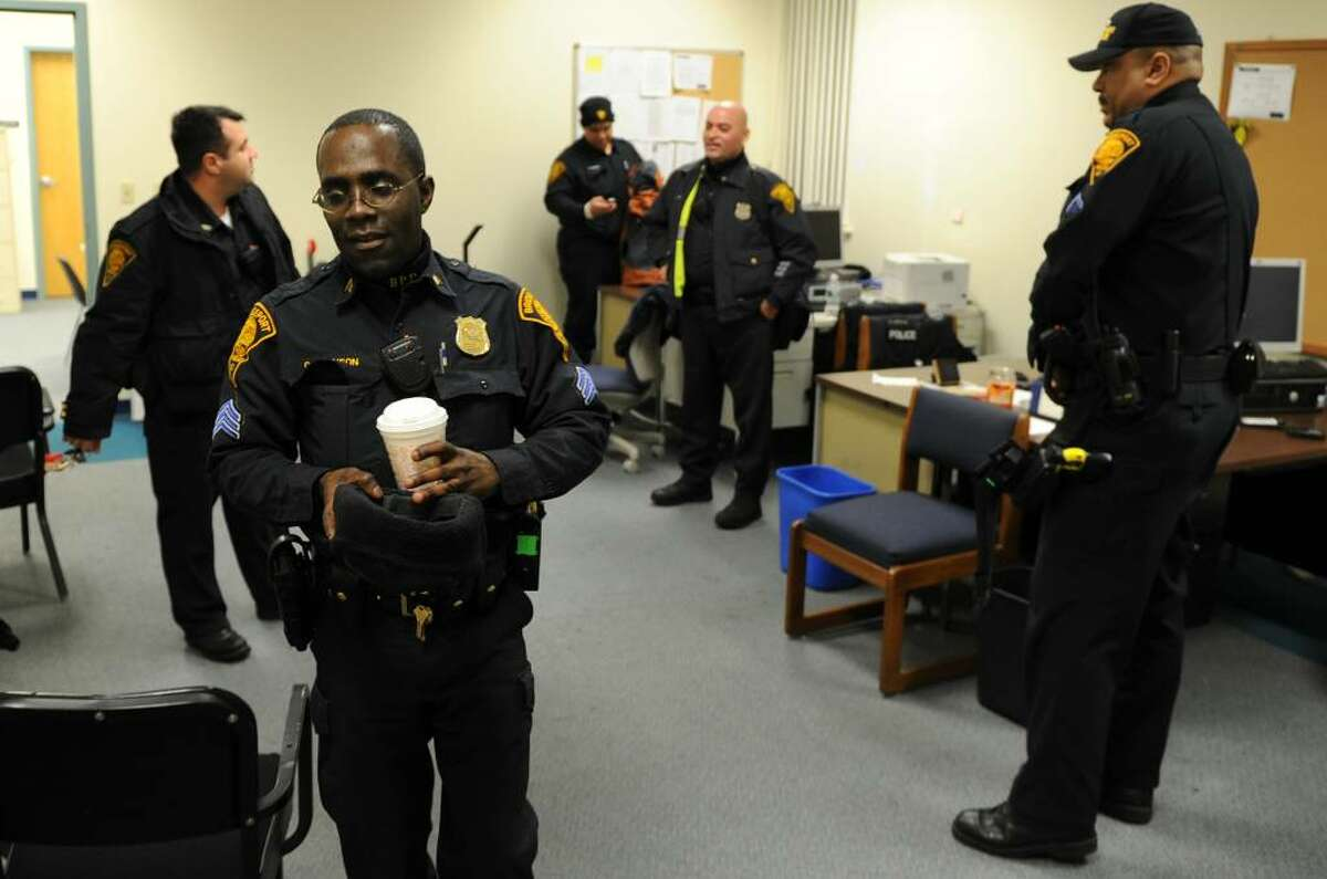 A pre-shift meeting, led by Sgt. Charles Johnson, breaks up at the West Side Precinct on State Street in Bridgeport, Conn. on Thursday January 28, 2010. Johnson is one of the new supervisors of the police department's SET team. He survived a head-on crash while on duty a year ago, and brings what he learned through the crash and recovery to his work now.