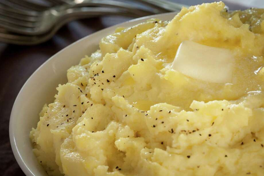 Of course there has to be piles of buttered mashed potatoes. And there must be butter ... lots of butter (and gravy). Photo: Michael Paulsen, Staff / © 2012 Houston Chronicle