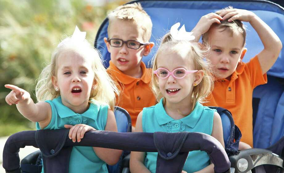 Three-year-old quadruplets, Lainey Peveto (left to right), Tanner, Avery and Cooper at a Houston Zoo event in March 2011. Photo: Michael Paulsen, Chronicle / Houston Chronicle