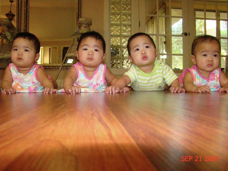 Galleria residents Van and Jordan Tran  From are the parents of quadruplets, left to right, identical twins Cameron and Kennedy and Austin and Madison. This photo was taken on Sept. 21, 2007.  Photo: Courtesy Tran Fami / handout
