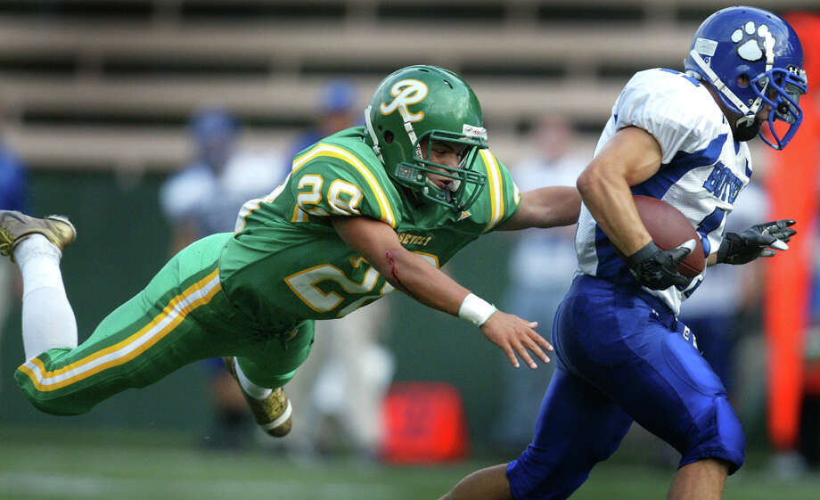 The male athletes at Roosevelt have been great too. Pictured is Roosevelt's Kyle Mealand flying through the air in an attempt to stop Bothell player Cory Burk at Memorial Stadium in 2007.  Photo: Joshua Trujillo, Seattle Post-Intelligencer File / Seattle Post-Intelligencer