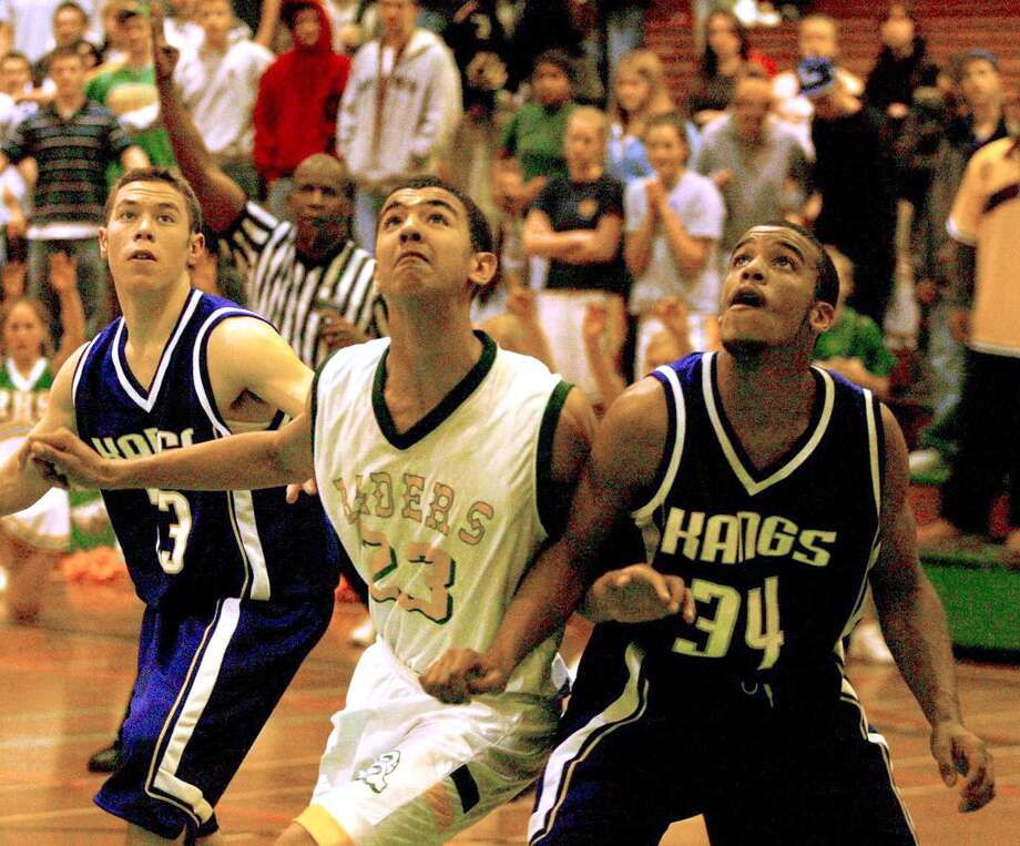 Girls basketball has gotten a lot of attention over the years, but the boys have been pretty good too. Pictured is Roosevelt's Marcus Williams, center, in 2003 battling for position against Lake Washington in the last minute of a game that Roosevelt won.  Photo: GRANT M. HALLER, Seattle Post-Intelligencer File