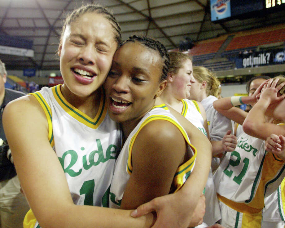 Roughrider basketball, 2004: Roosevelt's Breianna Gaines, left, hugs Darnellia Russell after Roosevelt's 55-52 win over Garfield in the girls' Class 4A championship game.  Photo: JOHN FROSCHAUER, Seattle Post-Intelligencer File / AP