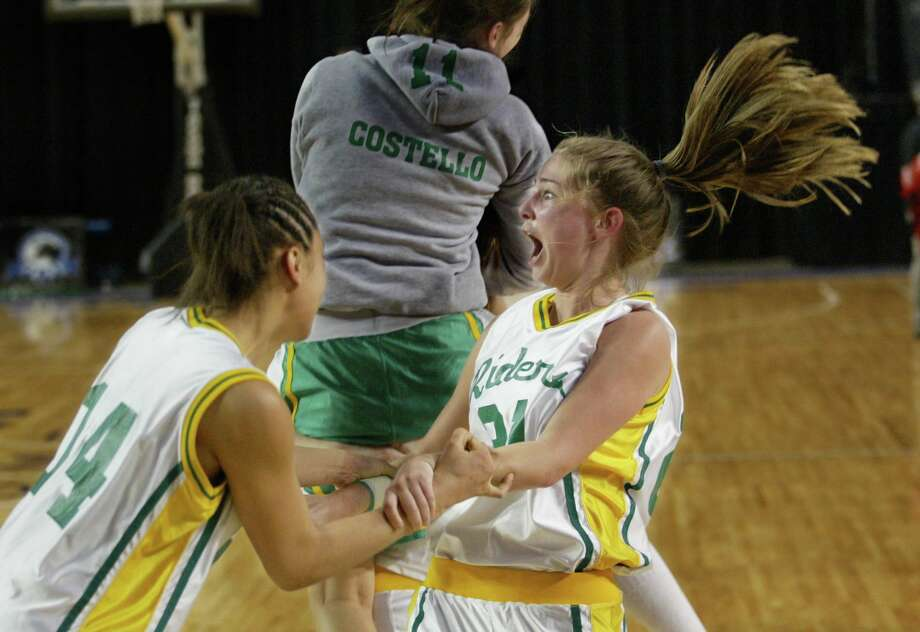 "A pivotal moment in Roughrider girls' basketball history: Roosevelt wins a game in the 4A state basketball championships against Snohomish High School in 2004, the year the documentary ""Heart of the Game"" was filmed. Pictured are Breianna Gaines (left) and Maggie Torrance.  Photo: Seattle Post-Intelligencer File"