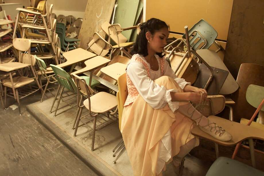 "Janelle Velasquez, who was part of Roosevelt's class of 2000, is pictured getting ready for the school's production of ""Brigadoon"" in 2000. Velasquez was featured in a P-I story about Seattle grads in the new millennium.  Photo: MIKE URBAN, Seattle Post-Intelligencer File"