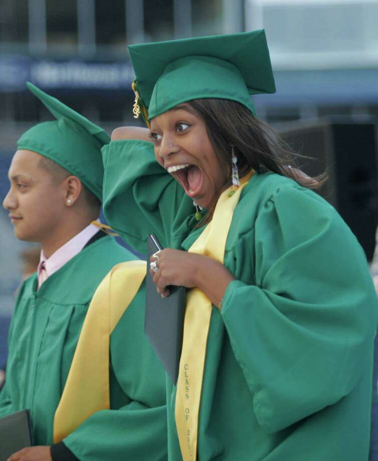 Roosevelt student Saba Girmay, right, celebrates during a graduation ceremony at Qwest Field in 2005.  Photo: NIKI DESAUTELS, Seattle Post-Intelligencer File