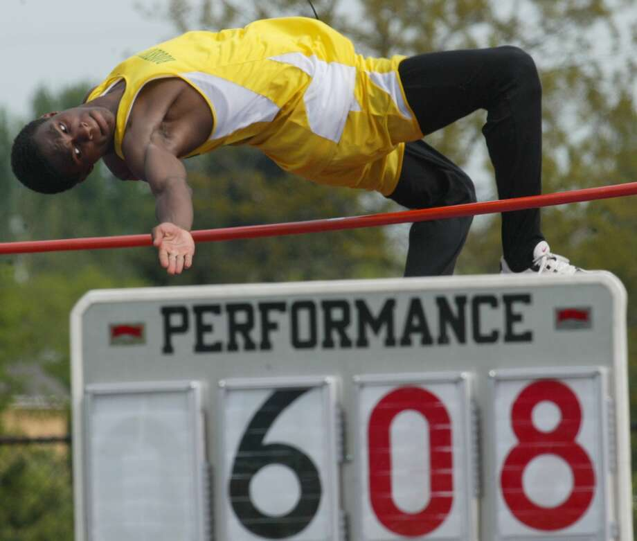 "Roosevelt's motto: ""What I am to be I am now becoming."" Pictured is Norris Frederick clearing the high jump at 6' 8"" to win a district championship in 2003.  Photo: GRANT M. HALLER, Seattle Post-Intelligencer File"