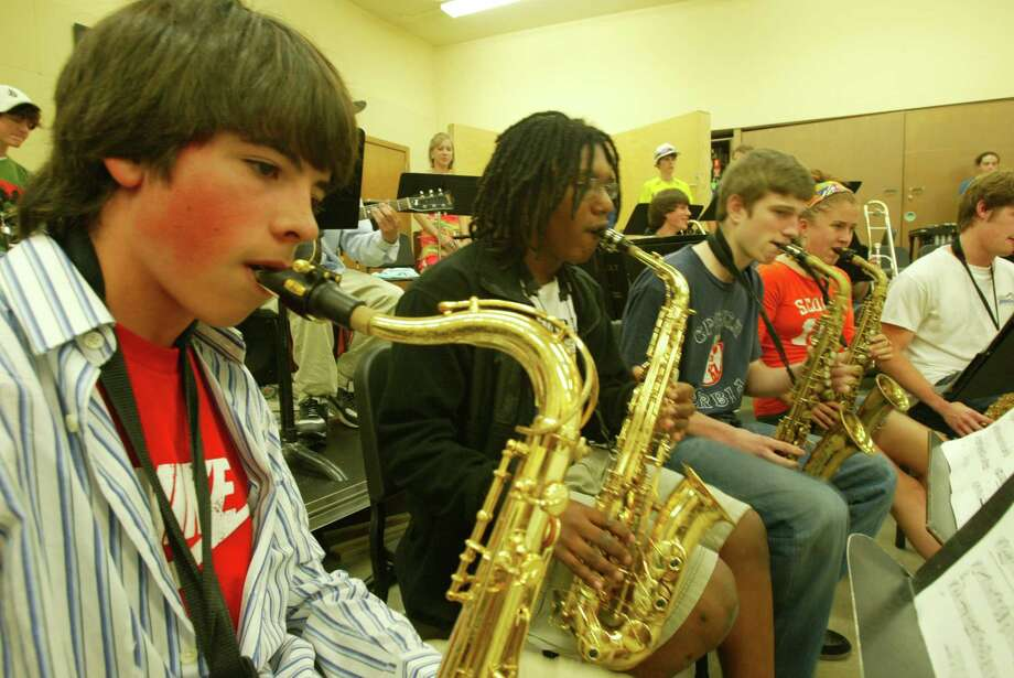 Roosevelt and its famous jazz band. Pictured is the sax section in 2005. From left: Spencer Leroux, Alex Dugdale, Logan Strosahl, Amy Huttchings and Gavin Calkins practicing at the old Lincoln High School, while Roosevelt was being remodeled at the time.  Photo: Grant M. Haller, Seattle Post-Intelligencer File / Seattle Post-Intelligencer