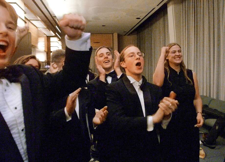Roosevelt jazz band students celebrate in 2000, after their big moment on stage with Wynton Marsalis at Avery Fisher Hall in New York. The band had gone there to play in the prestigious Essentially Ellington festival.  Photo: MERYL SCHENKER, Seattle Post-Intelligencer File