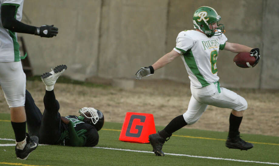 More Roughrider sports: Roosevelt running back Jared Grose crosses the goal line for a touchdown against Franklin High School in 2005 at Memorial Stadium.  Photo: Seattle Post-Intelligencer File / Seattle Post-Intelligencer