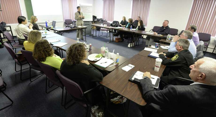 Lorrie Lynn, left, of the National Safety Council speaks to a group of parents Friday afternoon Nov. 8, 2013,  about speaking to teens about driving habits during a conference organized by the Northeastern New York Safety & Health Council in Albany, N.Y.     (Skip Dickstein / Times Union) Photo: Skip Dickstein / 00024580A