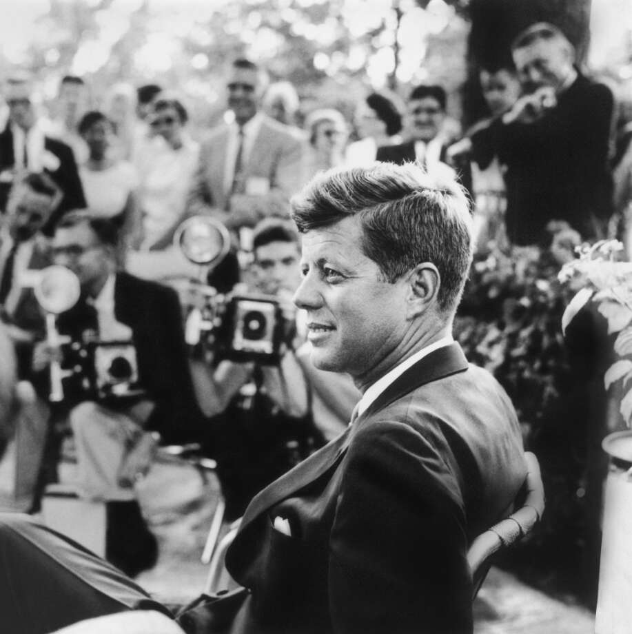 This handout photo provided by the Newseum, and the estate of Jacques Lowe, shows John F. Kennedy at a news conference in Omaha, Neb. in 1959.  Three cities loom large in the life and death of John F. Kennedy: Washington, D.C., where he served as U.S. president and as a senator; Dallas, where he died, and Boston, where he was born. With the 50th anniversary of his Nov. 22, 1963 assassination at hand, all three places are worth visiting to learn more about him or to honor his legacy.(AP Photo/Newseum, estate of Jacques Lowe) Photo: Courtesy Photo, Associated Press