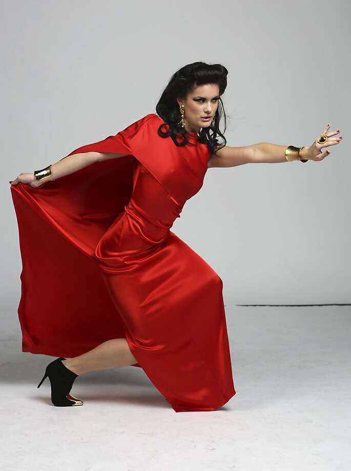 The lady in red: In San Antonio, Kimber Fox models a cape like a matador teases a bull. Photo: Helen L. Montoya, San Antonio Express-News