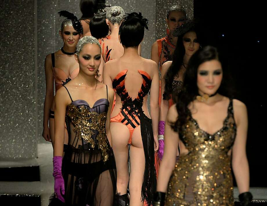 "Copy catwalk: Models walk down the runway during the filming of the lingerie portion of ""China's Next Top Model"" in Beijing. The show is of course modeled after ""America's Next Top Model."" Photo: Mark Ralston, AFP/Getty Images"