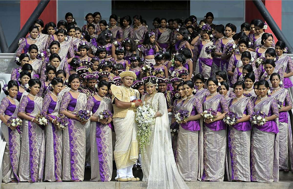 The best men's toasts took FOREVER: In Negombo, Sri Lanka, a couple named Nalin and Nisansala pose with their 126 bridesmaids during their Guinness World Record-breaking wedding. The newlyweds shattered the old mark of 96 bridesmaids held by a couple in Bangkok. Also included in the wedding party were 25 best men, 20 page boys and 23 flower girls.