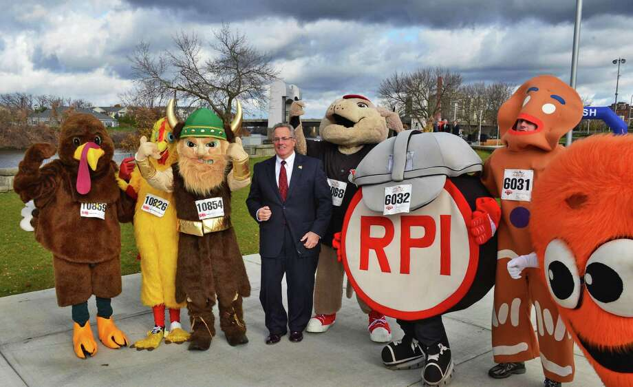 Mayor Lou Rosamilia, center, with costumed runners and regional mascots to promote the introduction of a costume contest in the 5K of this year's Troy Turkey Trot during a news conference in Riverfront Park Friday Nov. 8, 2013, in Troy, NY.  (John Carl D'Annibale / Times Union) Photo: John Carl D'Annibale / 00024577A