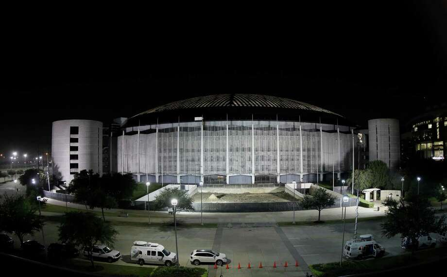 The exterior of the Astrodome's features slender columns with the spaces between them filled with concrete screens in a delicate diamond-shaped pattern. Photo: David J. Phillip, STF / AP
