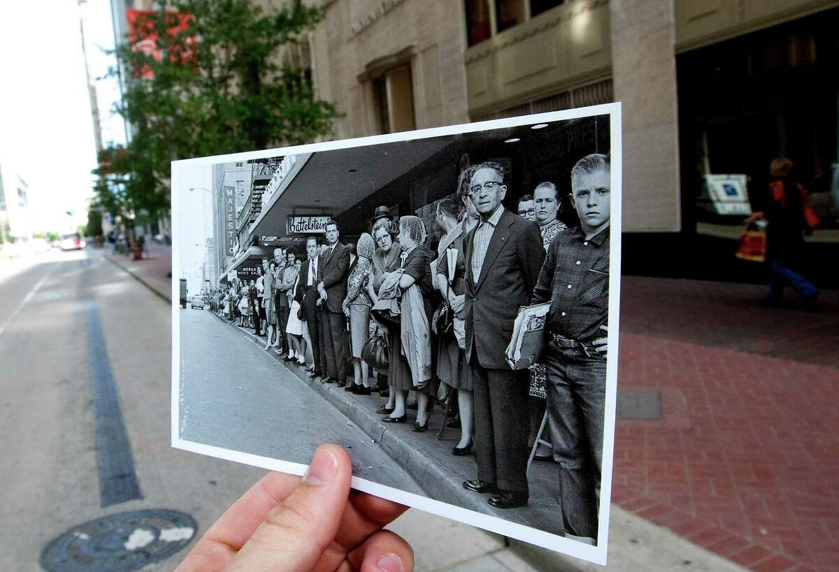 A photo taken November 21, 1963 of people lining Travis Street near Rusk St., to see President John F. Kennedy's motorcade is juxtaposed against the current scene, Thursday, Nov. 7, 2013, in Houston.