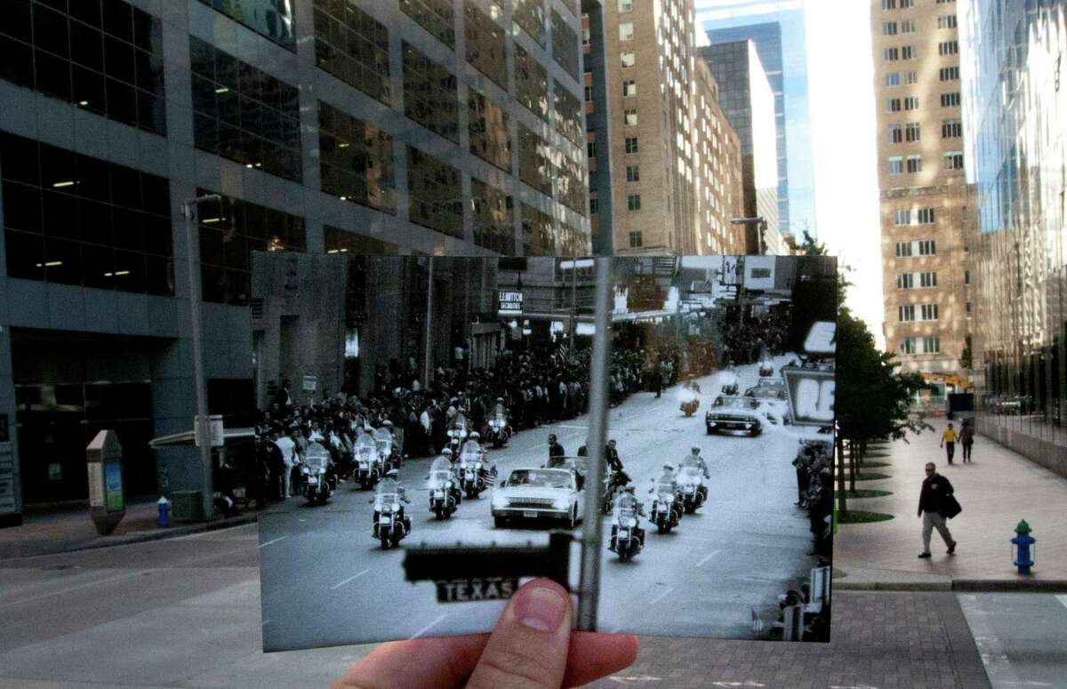 A photo taken November 21, 1963 of people lining Travis Street near Texas Avenue to see President John F. Kennedy's motorcade is juxtaposed against the current scene, Thursday, Nov. 7, 2013, in Houston.