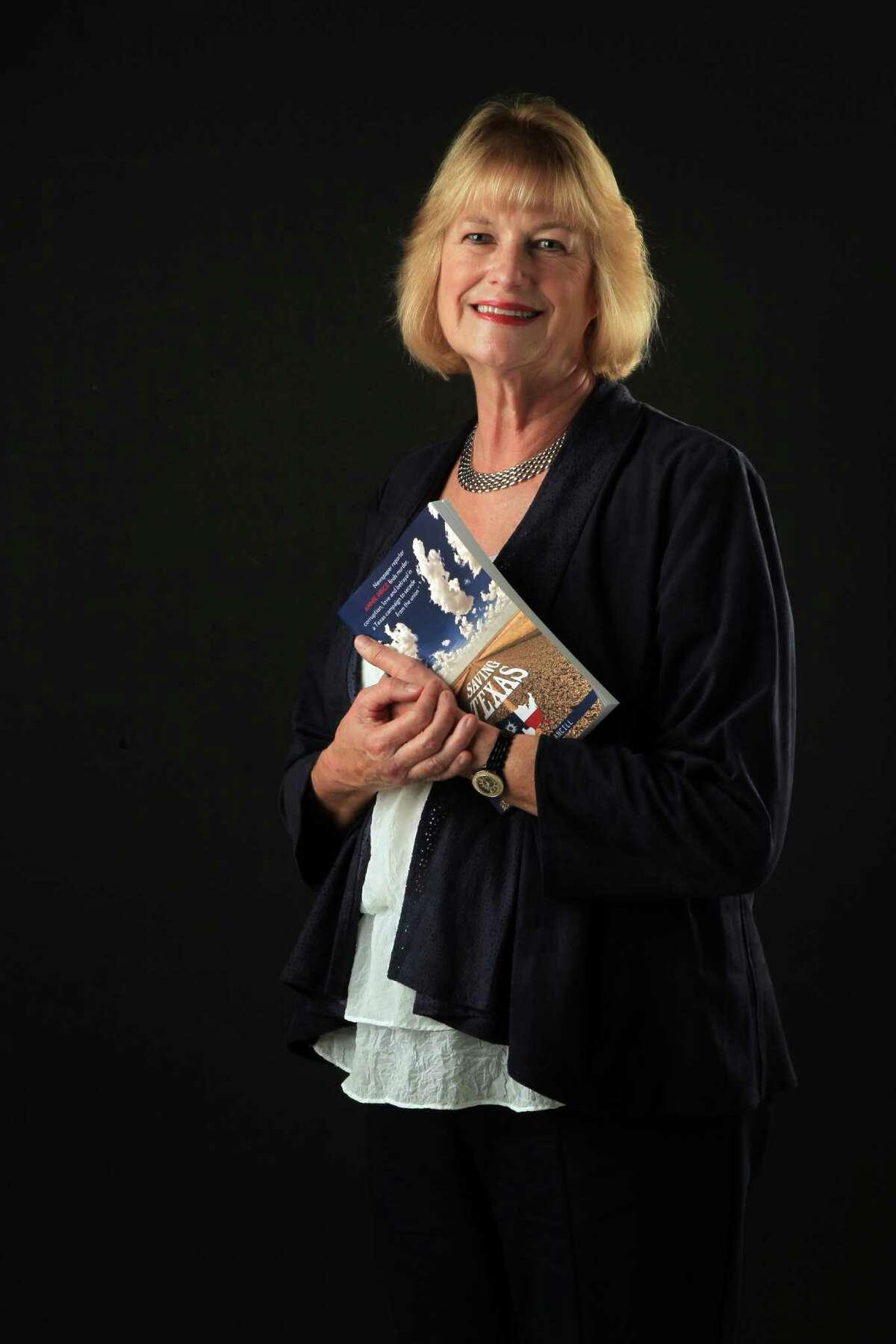 Nancy Stancill has written a murder mystery book based in Texas called Saving Texas on Tuesday, Oct. 22, 2013, in Houston. ( Mayra Beltran / Houston Chronicle )