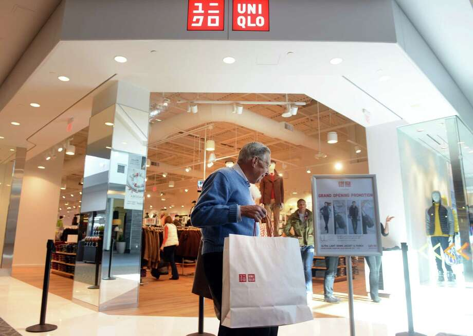 Edna and John Henchy, of Stratford, leave UNIQLO's new Westfield Trumbull Mall store Friday, Nov. 8, 2013 after shopping their grand opening sale. Photo: Autumn Driscoll / Connecticut Post