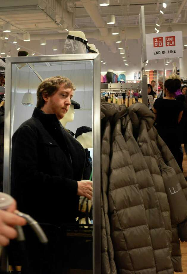 Jeremy Hanifin, of Trumbull, shops at UNIQLO's new Westfield Trumbull Mall store Friday, Nov. 8, 2013 during their grand opening sale. Photo: Autumn Driscoll / Connecticut Post