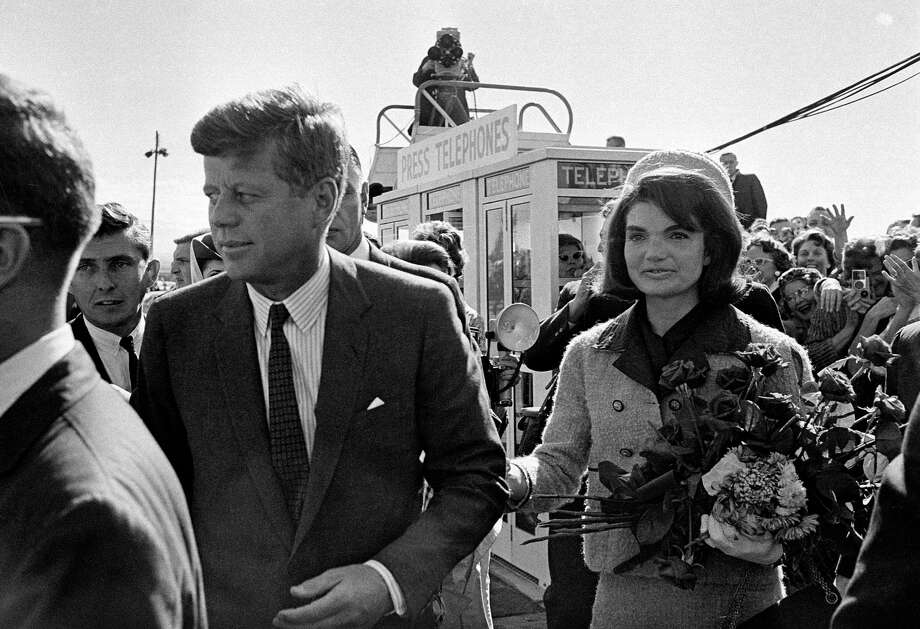 FILE - In this Nov. 22, 1963 file photo, President John F. Kennedy and his wife, Jacqueline Kennedy, arrive at Love Field airport in Dallas. (AP Photo/File) Photo: STF / AP