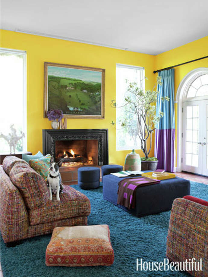 "Yellow""Bright sunshine yellow has the same high energy as you do when you set your mind on a goal,"" color expert Kate Smith says. ""A unique mix of several bold colors says that you make you own rules — and you inspire others with how you experience life fully,"" color expert Kate Smith says. This media room in a Malibu house designed by Todd Nickey and Amy Kehoe has the same high energy feel, it's a happy riot of color — the walls are saturated with Sun Porch by Benjamin Moore.