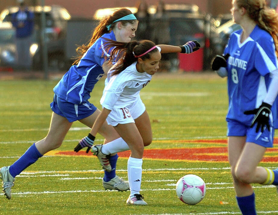 St. Joesph's Adrienne Williams tries to fend off Fairfield Ludlowe's Caroline Rooney, left, during Class LL girls soccer quarterfinal action in Trumbull, Conn. on Friday November 8, 2013. Photo: Christian Abraham / Connecticut Post