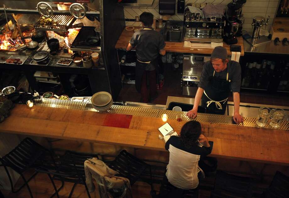 Bartender Tim Zohn talks to a customer at TBD. Photo: Sarah Rice, Special To The Chronicle