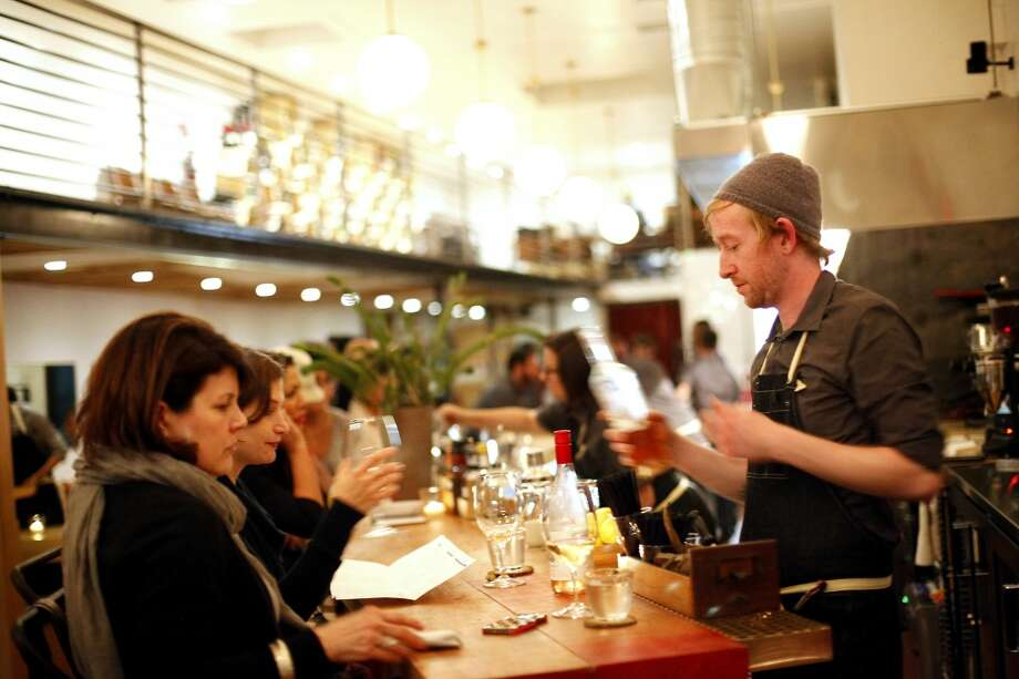 Bartender Tim Zohn mixes drinks at TBD. Photo: Sarah Rice, Special To The Chronicle