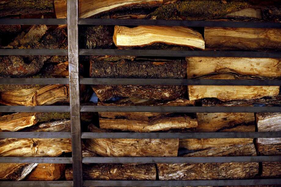 TBD stocked with plenty of wood for its custom built grill in San Francisco. Photo: Sarah Rice, Special To The Chronicle