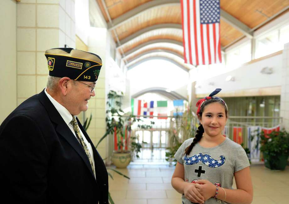 Fifth grade student Samantha Fahey talks with World War II veteran Tom Quinn Friday, Nov. 8, 2013 during a special visit to McKinley Elementary School for an assembly program honoring veterans. Photo: Autumn Driscoll / Connecticut Post