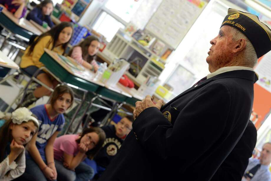 World War II veteran Ed Crowley takes questions from fifth graders about his military service during the war Friday, Nov. 8, 2013 during a special visit to McKinley Elementary School for an assembly program honoring veterans. Photo: Autumn Driscoll / Connecticut Post