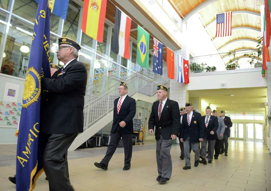 Veterans march into an assembly Friday, Nov. 8, 2013 at McKinley Elementary School in honor of Veteran's Day. Photo: Autumn Driscoll / Connecticut Post