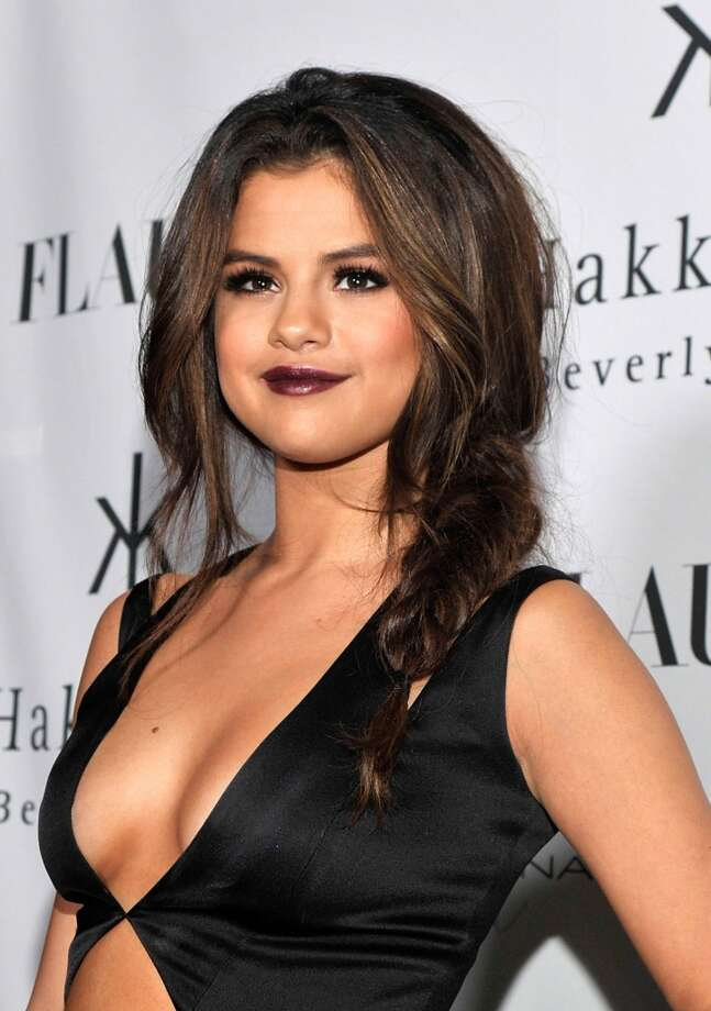 Actress Selena Gomez attends the Flaunt Magazine En Garde! Issue launch party with Selena Gomez and Amanda De Cadenet at Hakkasan Restaurant Beverly Hills on November 7, 2013 in Beverly Hills, California. Photo: John M. Heller, Getty Images