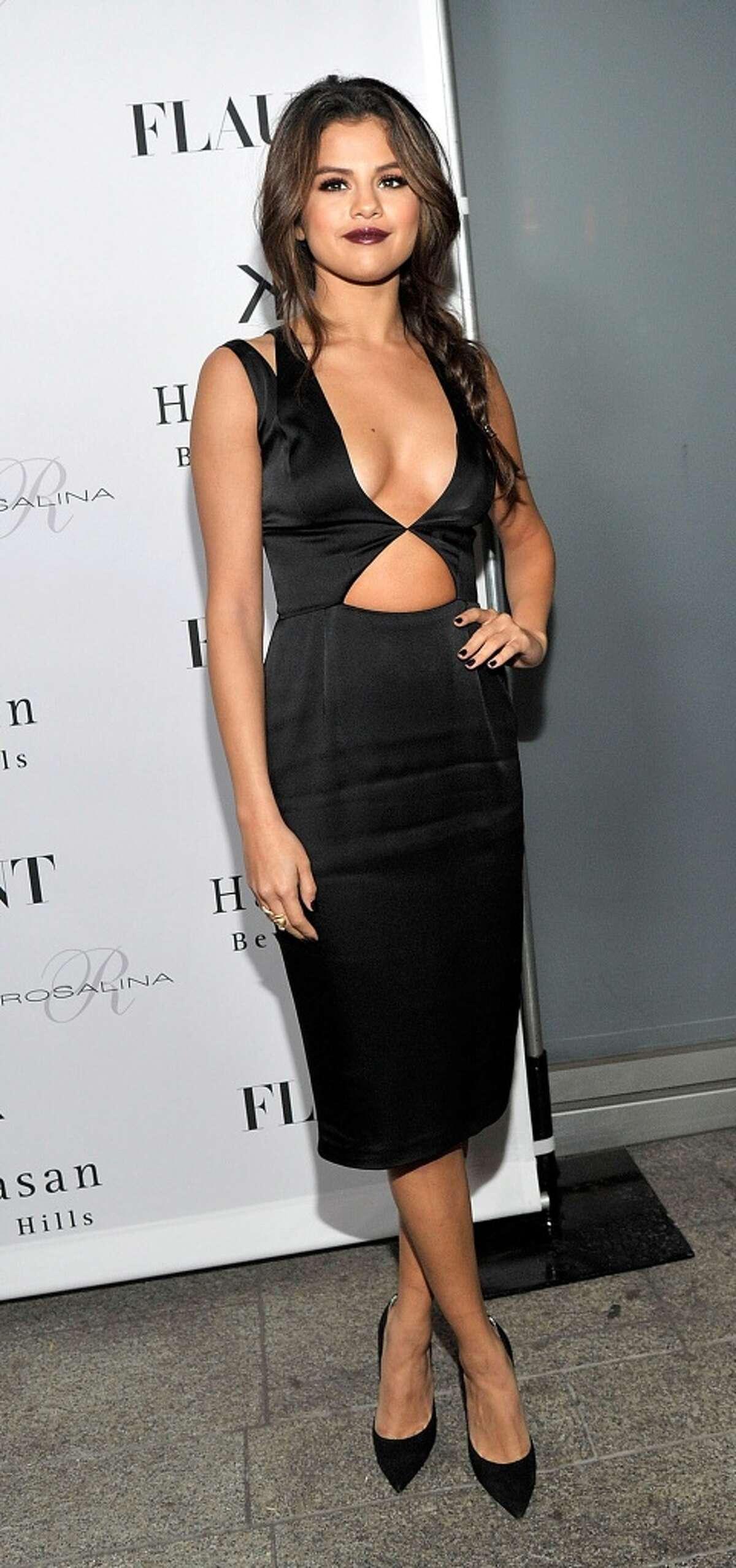 Actress Selena Gomez attends the Flaunt Magazine En Garde! Issue launch party with Selena Gomez and Amanda De Cadenet at Hakkasan Restaurant Beverly Hills on November 7, 2013 in Beverly Hills, California.