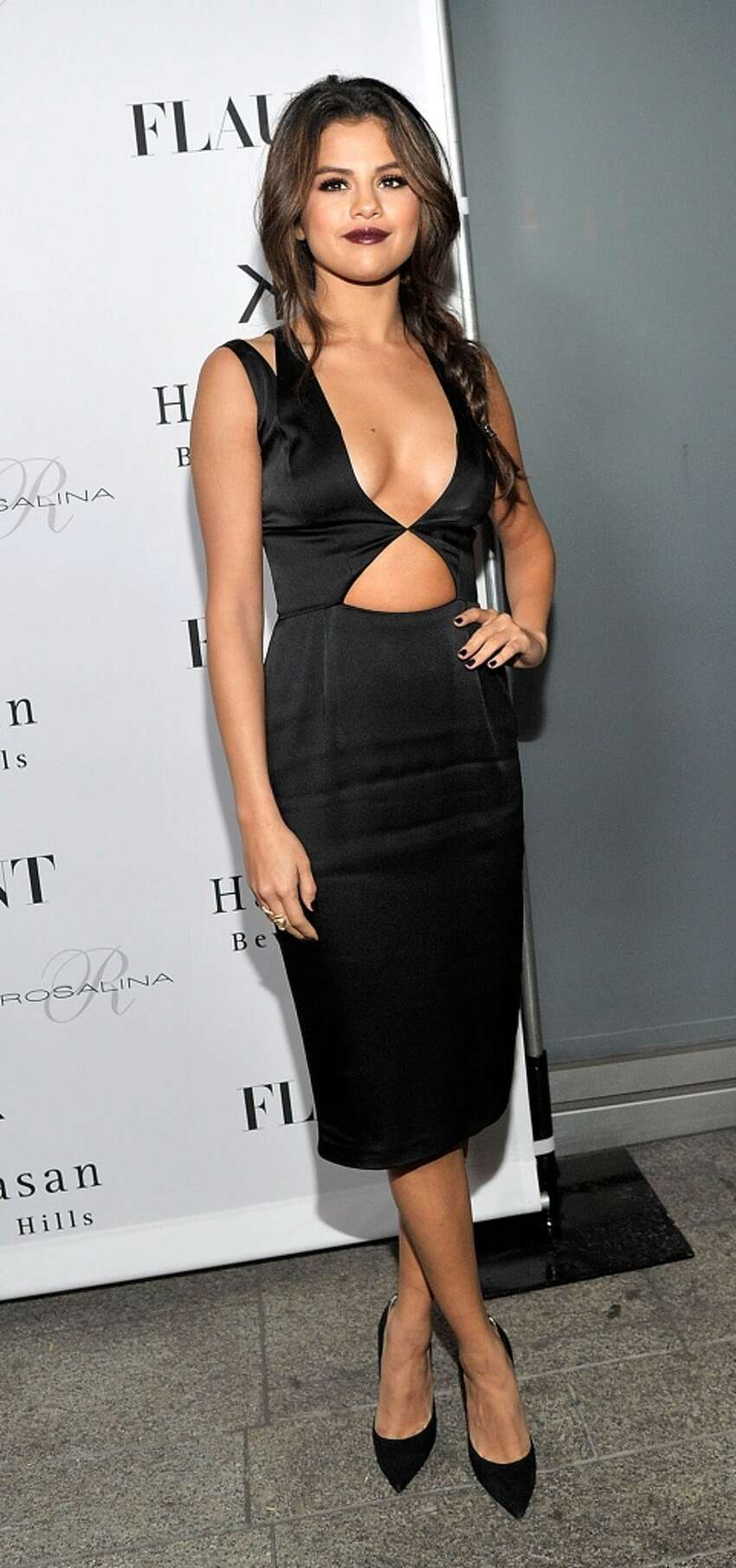 Actress Selena Gomez attends the Flaunt Magazine En Garde! Issue launch party with Selena Gomez and Amanda De Cadenet at Hakkasan Restaurant Beverly Hills on November 7, 2013 in Beverly Hills, California.