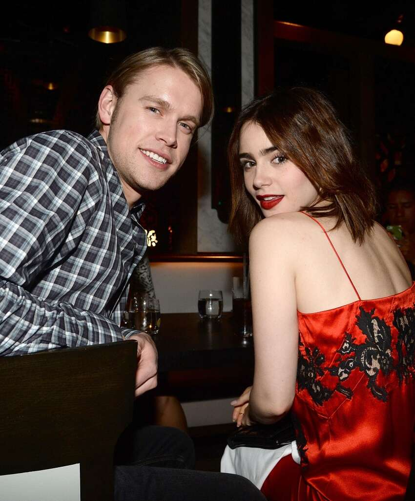 Actors Chord Overstreet and Lily Collins attend the Flaunt Magazine November issue party at Hakkasan on November 7, 2013 in Beverly Hills, California.