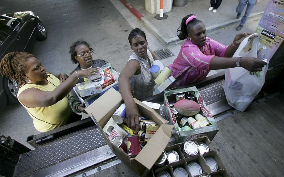 Bay Area charities gathered food for victims of Hurricane Katrina. Photo: Brant Ward, SFC