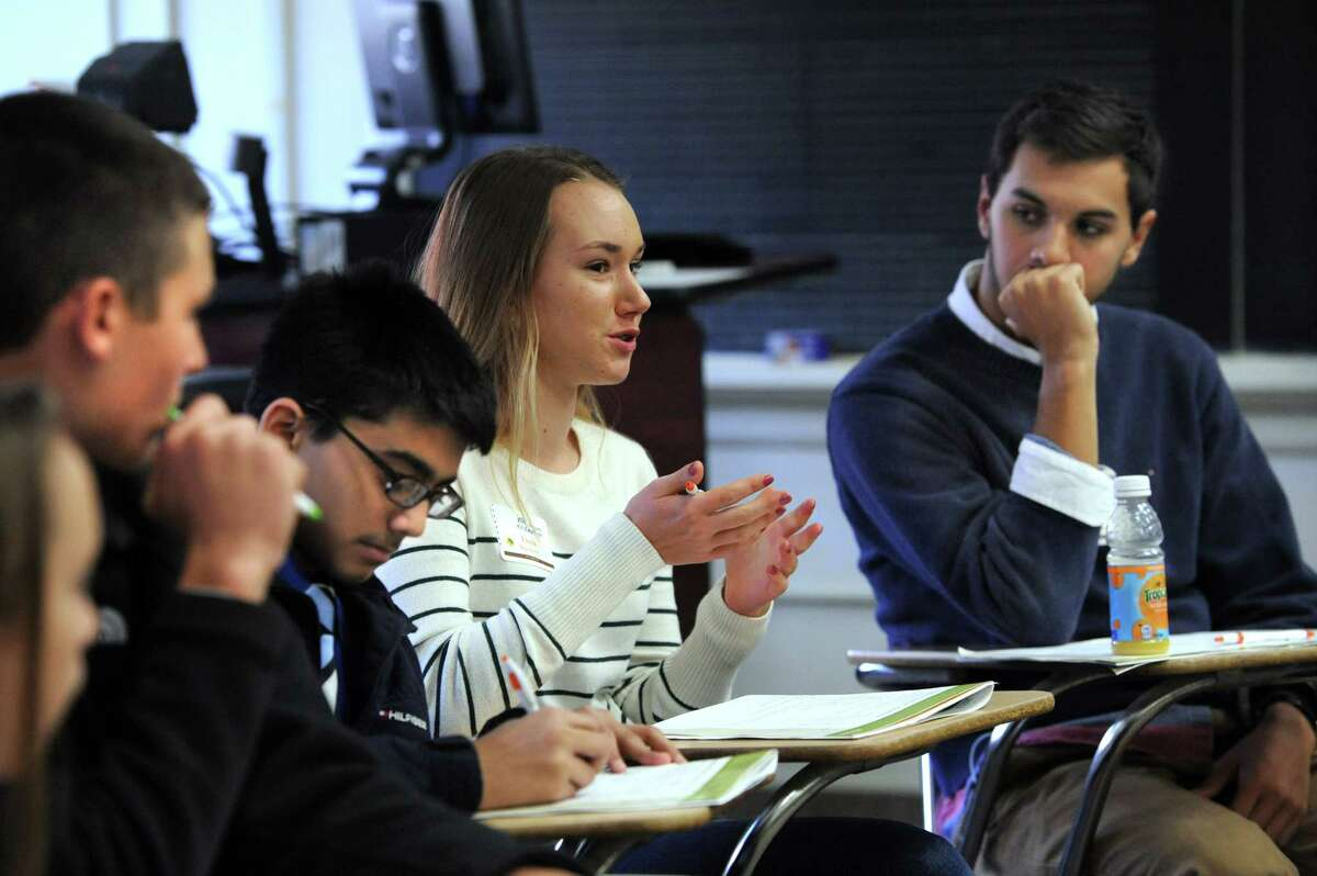 Fiona Brockner, 14, of New Fairfield, Conn., center, speaks during a Kiwanis Leadership Program held at Western Connecticut State University, Friday, Nov. 8, 2013. The program's aim is to develop leadership initiative in students to cultivate a culture of kindness and respect among their peers.
