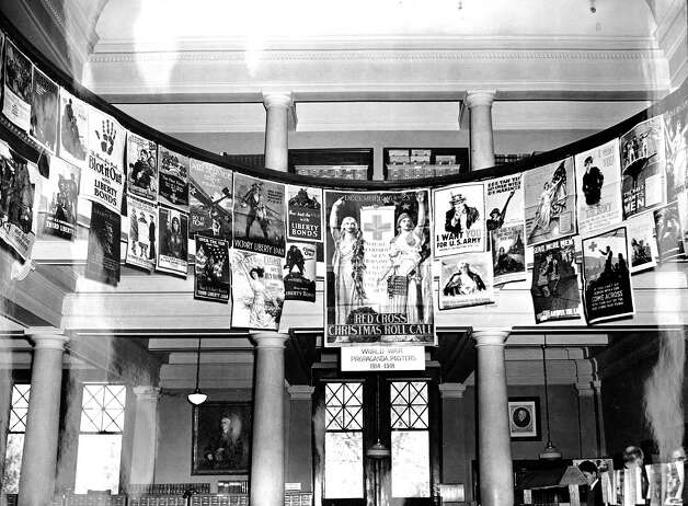 Some of the World War I posters from the Washington State University's collection are shown on display in the then Washington State College Library in Bryan Hall in the 1940s.Click on for more World War I and II posters. Photo: Washington State University