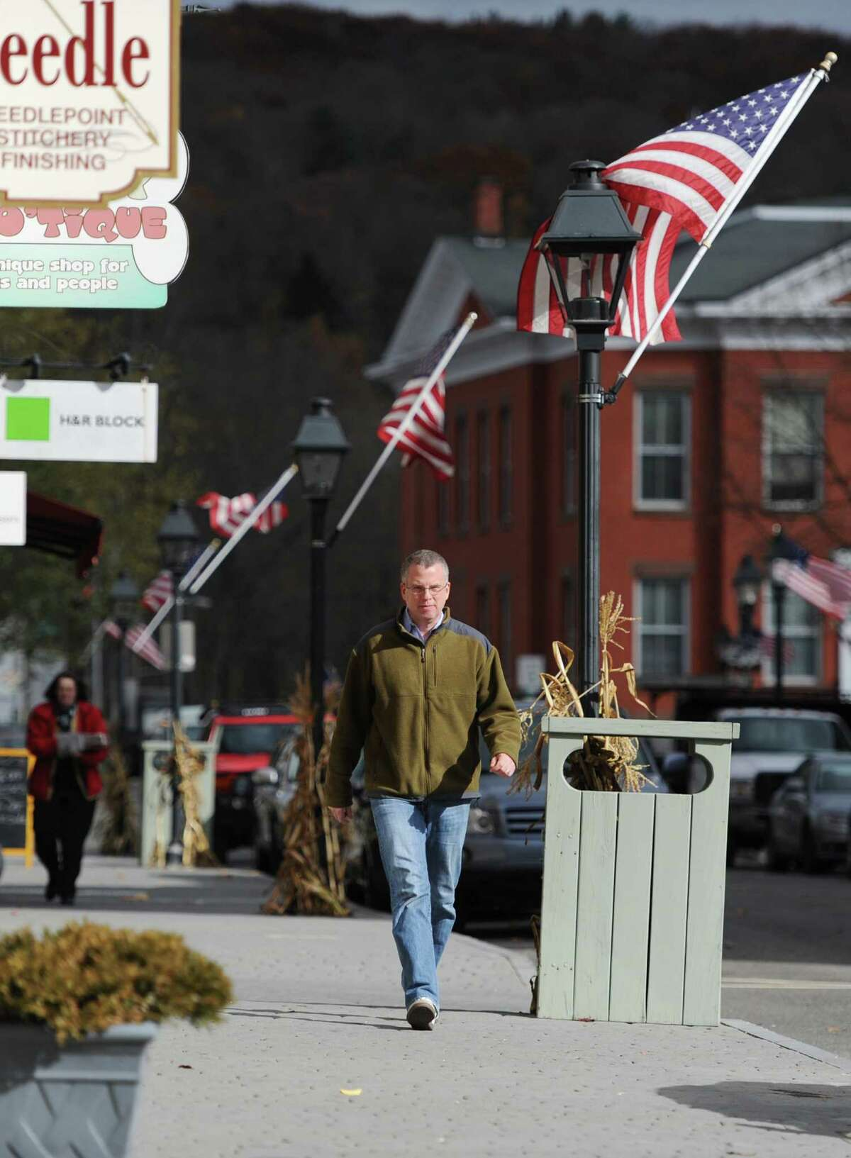 Tony Vengrove, of New Milford, walks down Bank Street in New Milford, Conn. on Friday, Nov. 8, 2013. New Milford is one of the most walkable towns in the area, ranking second out of 31 towns with a score of 88 according to Walkscore.com.