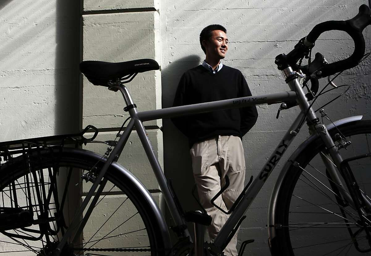 Zilong Wang, on Thursday Nov. 7, 2013, is pictured with the bike he rode across the U.S. with, which he now uses for his commute to and from work in San Francisco, Calif. The adventures of Zilong Wang have taken him from a tiny Mongolian province in China to the East Coast and then across the country on a bicycle to San Francisco, where he is now working for a tech start up. Wang spent this past summer riding across America, knocking on doors of strangers every night looking for a place to stay.