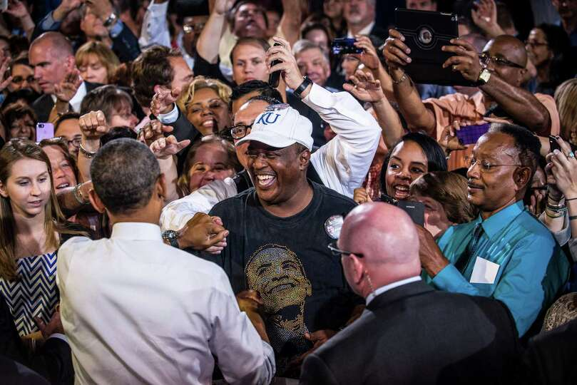 President Barack Obama greets supporters after a speech on the economy, at the Uptown Theater in Kan