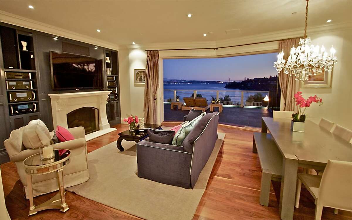 The great room features sliding glass doors that open to an unobstructed view of San Francisco Bay.