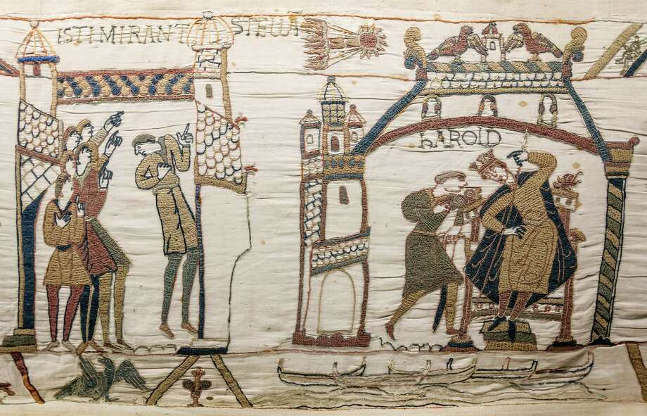 Records show that HalleyâÄôs Comet has been observed for over 2000 years. Confirmed sightings of the comet go back to 240 B.C. Shown here is the Bayeux Tapestry, commemorating the Norman conquest of England in 1066 A.D. HalleyâÄôs comet appeared in the sky shortly before the battle, as depicted at top center on the tapestry. Photo: Contributed Photo / The News-Times Contributed