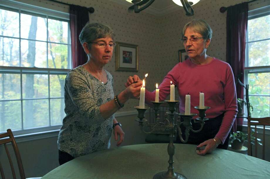 Same-sex couple Anne Corey (left), from a Reform Jewish background, and Connie Knapp, born and raised Catholic but now a Presbyterian, live in Ossining, N.Y. They have struggled to find an official for their interfaith ceremony. Photo: New York Times