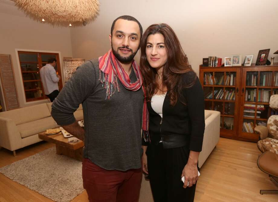 "Filmmakers Karim Amer (left) and Jehane Noujaim attend the screening for ""The Square"" at the home of Maria Bello on October 11, 2013 in Santa Monica, California.  (Photo by Christopher Polk/Getty Images). Noujaim is scheduled to attend the Nov. 14 SFFS event in San Francisco. Photo: Christopher Polk, Getty Images"