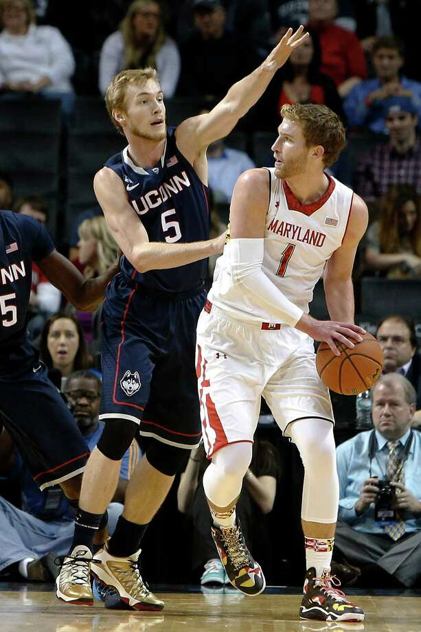 Connecticut's Niels Giffey (5) guards Maryland's Evan Smotrycz (1) during the first half of an NCAA college basketball game Friday, Nov. 8, 2013, in New York. Photo: Jason DeCrow, AP / Associated Press